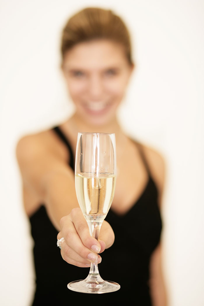 Frau mit Sektglas